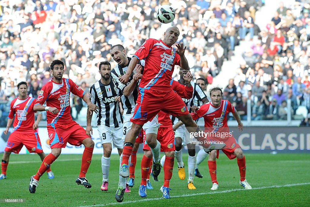 Giorgio Chiellini (L) of FC Juventus clashes with Sergio Bernardo Almiron of Calcio Catania during the Serie A match between FC Juventus and Calcio Catania at Juventus Arena on March 10, 2013 in Turin, Italy.
