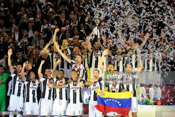 Giorgio Chiellini Of FC Juventusraises the trophy of the Italian Cup during the TIM Cup Final match between SS Lazio and Juventus FC at Olimpico...