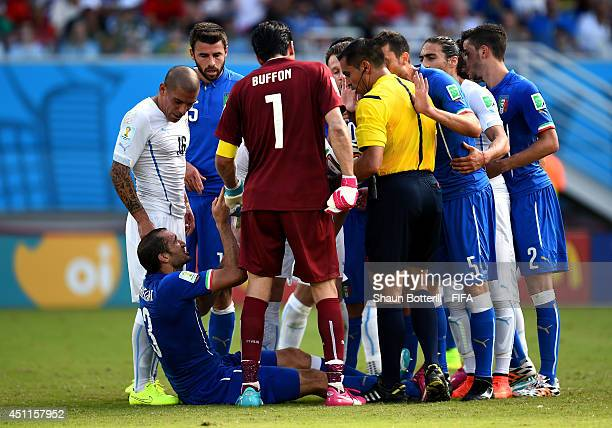 Giorgio Chiellini of Italy appeals to referee Marco Rodriguez after a clash with Luis Suarez of Uruguay during the 2014 FIFA World Cup Brazil Group D...