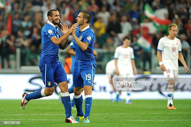 Giorgio Chiellini of Italy celebrates his goal with team mate Leonardo Bonucci during the FIFA 2014 World Cup Qualifier group B match between Italy...
