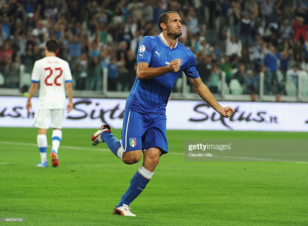 <a gi-track='captionPersonalityLinkClicked' href=/galleries/search?phrase=Giorgio+Chiellini&family=editorial&specificpeople=605793 ng-click='$event.stopPropagation()'>Giorgio Chiellini</a> of Italy celebrates scoring the first goal during the FIFA 2014 World Cup Qualifier group B match between Italy and Czech Republic at Juventus Arena on September 10, 2013 in Turin, Italy.