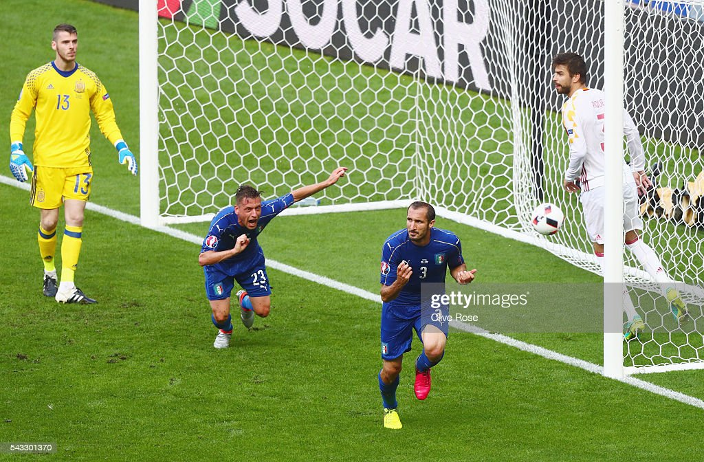 Giorgio Chiellini (2nd R) of Italy celebrates scoring the opening goal during the UEFA EURO 2016 round of 16 match between Italy and Spain at Stade de France on June 27, 2016 in Paris, France.