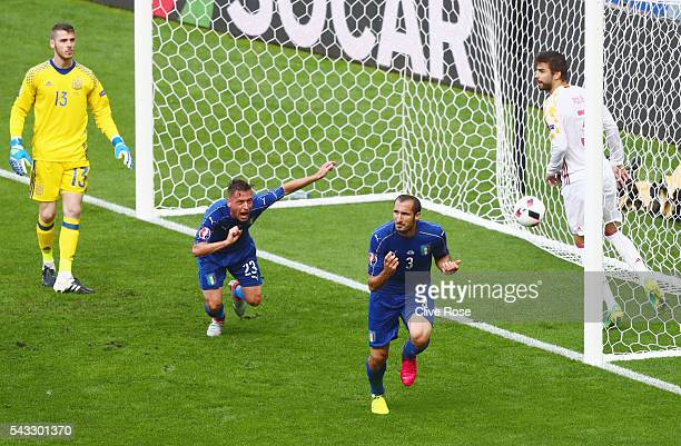 Giorgio Chiellini of Italy celebrates scoring the opening goal during the UEFA EURO 2016 round of 16 match between Italy and Spain at Stade de France...