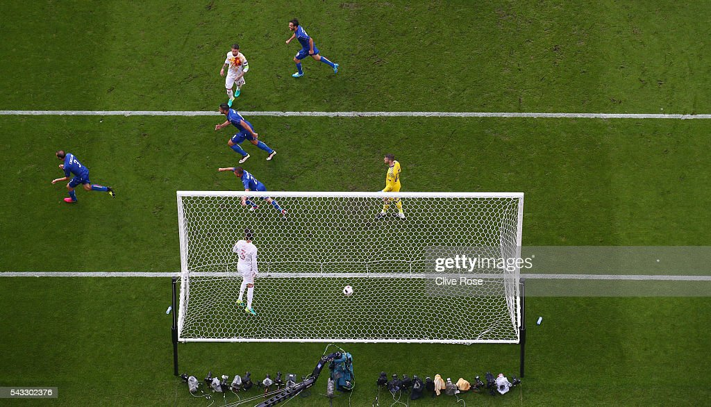 <a gi-track='captionPersonalityLinkClicked' href=/galleries/search?phrase=Giorgio+Chiellini&family=editorial&specificpeople=605793 ng-click='$event.stopPropagation()'>Giorgio Chiellini</a> (1st L) of Italy celebrates scoring the opening goal during the UEFA EURO 2016 round of 16 match between Italy and Spain at Stade de France on June 27, 2016 in Paris, France.