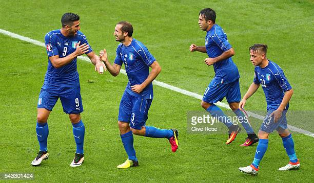 Giorgio Chiellini of Italy celebrates scoring the opening goal withi his team mates Graziano Pelle Eder and Emanuele Giaccherini during the UEFA EURO...