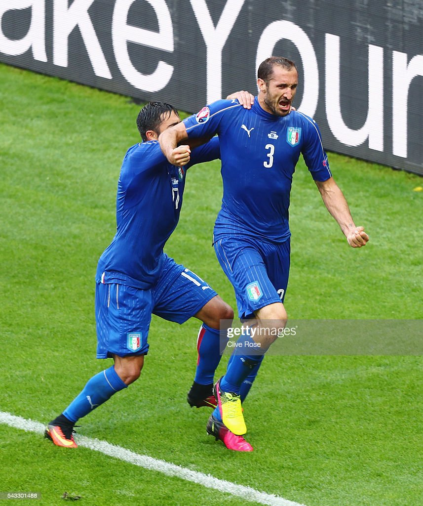 Giorgio Chiellini (r) of Italy celebrates scoring with Eder after scoring the opening goal with his team mate Eder (L) during the UEFA EURO 2016 round of 16 match between Italy and Spain at Stade de France on June 27, 2016 in Paris, France.
