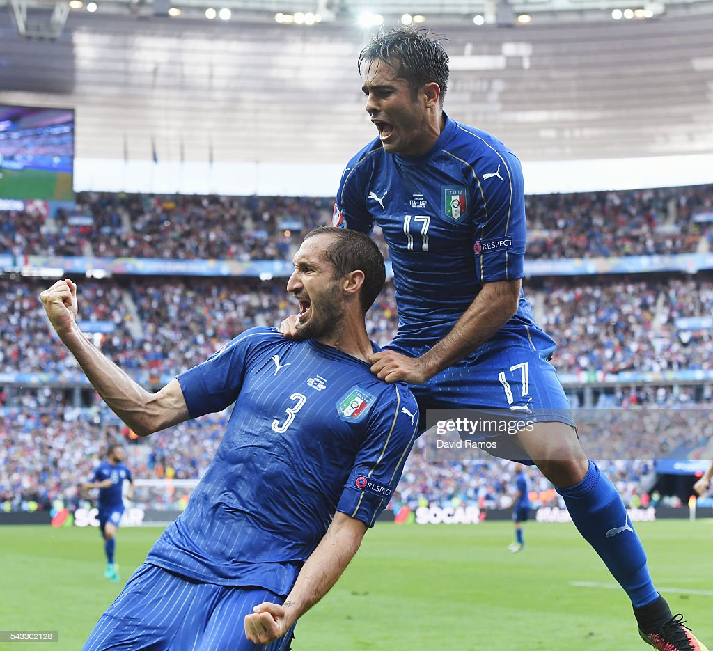 Giorgio Chiellini (L) of Italy celebrates scoring with Eder after scoring the opening goal with his team mate Eder (R) during the UEFA EURO 2016 round of 16 match between Italy and Spain at Stade de France on June 27, 2016 in Paris, France.