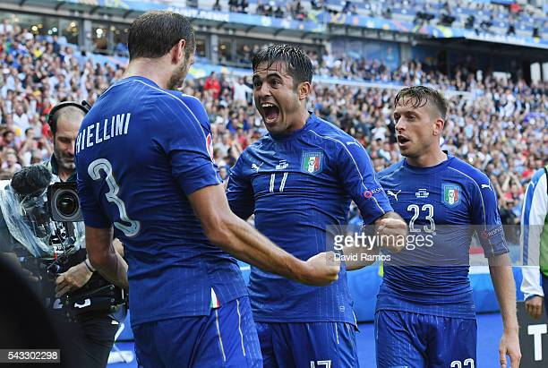 Giorgio Chiellini of Italy celebrates scoring with Eder after scoring the opening goal with his team mate Eder and Emanuele Giaccherini during the...