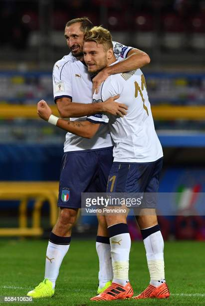 Giorgio Chiellini of Italy celebrates with Ciro Immobile after scoring the opening goal during the FIFA 2018 World Cup Qualifier between Italy and...