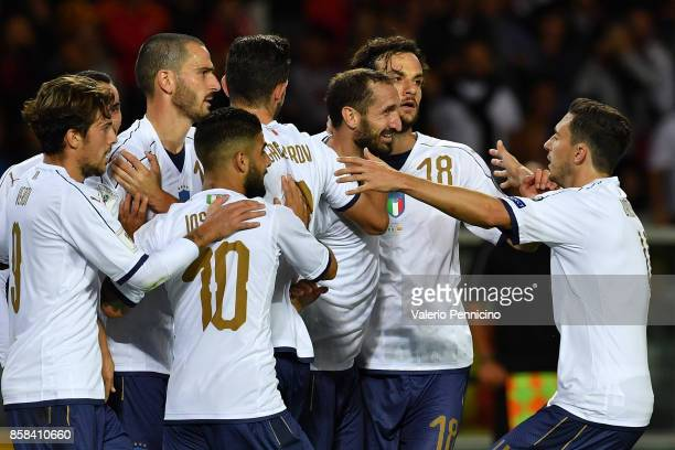 Giorgio Chiellini of Italy celebrates with teammates after scoring the opening goal during the FIFA 2018 World Cup Qualifier between Italy and FYR...