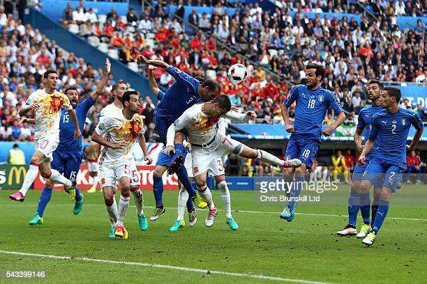 Giorgio Chiellini of Italy jumps for a header with Alvaro Morata of Spain during the UEFA Euro 2016 Round of 16 match between Italy and Spain at...