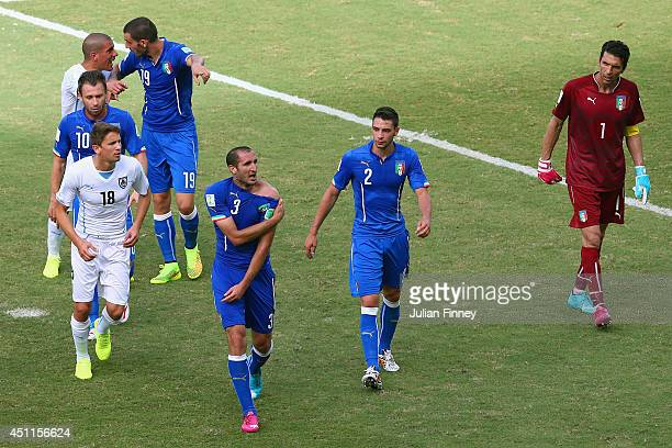 Giorgio Chiellini of Italy pulls down his shirt after a clash with Luis Suarez of Uruguay during the 2014 FIFA World Cup Brazil Group D match between...