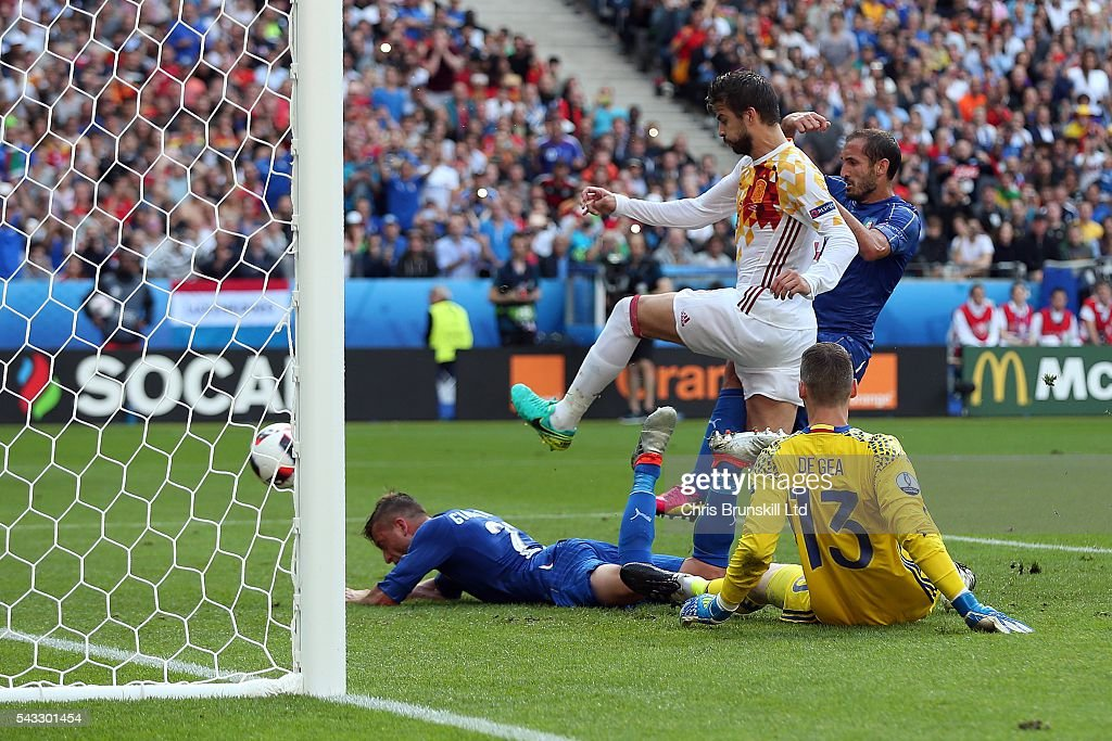 <a gi-track='captionPersonalityLinkClicked' href=/galleries/search?phrase=Giorgio+Chiellini&family=editorial&specificpeople=605793 ng-click='$event.stopPropagation()'>Giorgio Chiellini</a> of Italy scores the opening goal during the UEFA Euro 2016 Round of 16 match between Italy and Spain at Stade de France on June 27, 2016 in Paris, France.