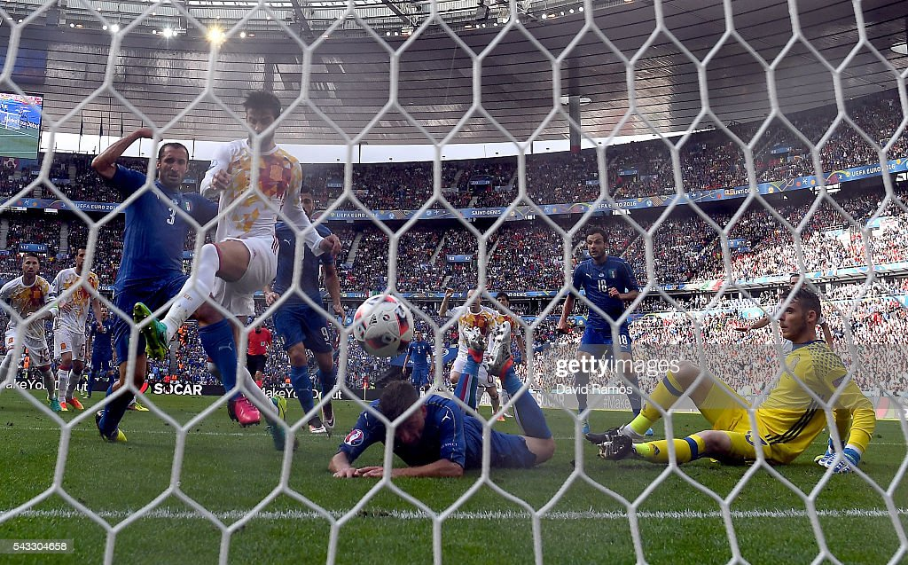 <a gi-track='captionPersonalityLinkClicked' href=/galleries/search?phrase=Giorgio+Chiellini&family=editorial&specificpeople=605793 ng-click='$event.stopPropagation()'>Giorgio Chiellini</a> (1st L) of Italy scores the opening goal during the UEFA EURO 2016 round of 16 match between Italy and Spain at Stade de France on June 27, 2016 in Paris, France.