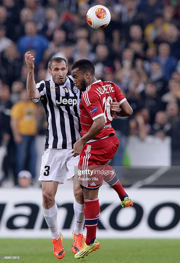 Giorgio Chiellini of Juventus #3 and Alexandre Lacazette of Lyon compete for the ball during the UEFA Europa League quarter final match between Juventus and Olympique Lyonnais at Juventus Arena on April 10, 2014 in Turin, Italy.