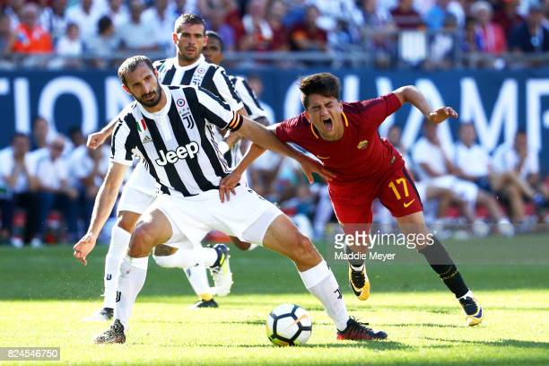 Giorgio Chiellini of Juventus and Cengiz Under of Roma battle for control of the ball during the International Champions Cup 2017 match at Gillette...