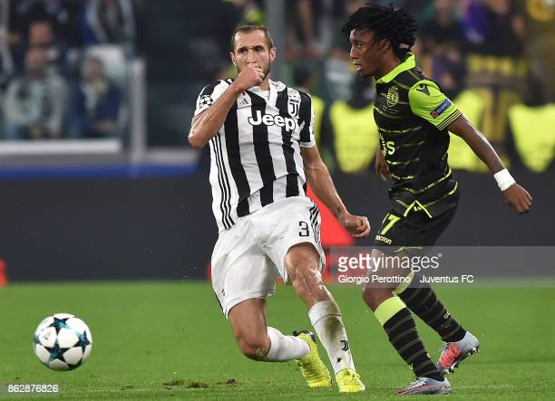Giorgio Chiellini of Juventus and Gelson Martins of Sporting compete for the ball during the UEFA Champions League group D match between Juventus and...
