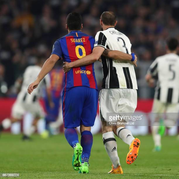 Giorgio Chiellini of Juventus and Luis Suarez of FC Barcelona embrace during the UEFA Champions League Quarter Final first leg match between Juventus...