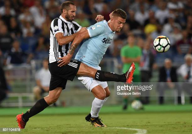 Giorgio Chiellini of Juventus and Sergej Milinkovic Savic of SS Lazio in action during the Italian Supercup match between Juventus and SS Lazio at...