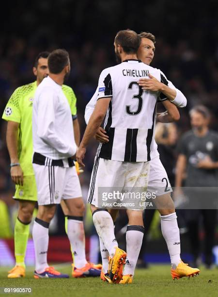 Giorgio Chiellini of Juventus and Stephan Lichtsteiner of Juventus embrace after the UEFA Champions League Final between Juventus and Real Madrid at...