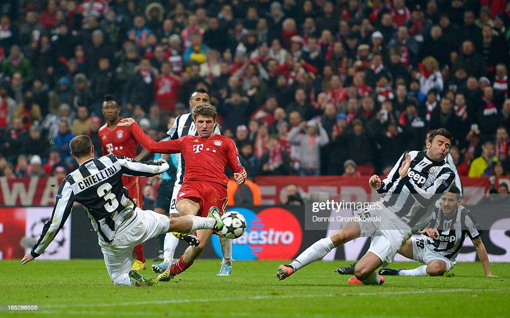 Giorgio Chiellini of Juventus attempts to block the shot by Thomas Muller of FC Bayern Muenchen during the UEFA Champions League quarter final first leg match between FC Bayern Muenchen and Juventus at Allianz Arena on April 2, 2013 in Munich, Germany.