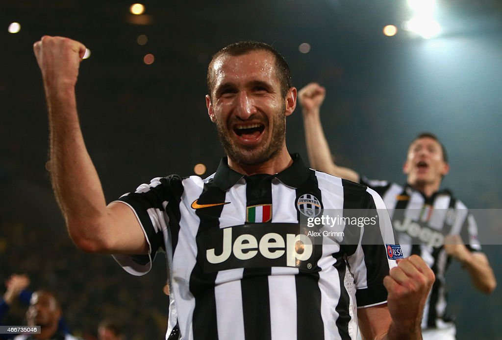 <a gi-track='captionPersonalityLinkClicked' href=/galleries/search?phrase=Giorgio+Chiellini&family=editorial&specificpeople=605793 ng-click='$event.stopPropagation()'>Giorgio Chiellini</a> of Juventus celebrates victory after the UEFA Champions League Round of 16 between Borussia Dortmund and Juventus at Signal Iduna Park on March 18, 2015 in Dortmund, Germany.