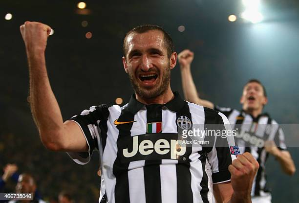 Giorgio Chiellini of Juventus celebrates victory after the UEFA Champions League Round of 16 between Borussia Dortmund and Juventus at Signal Iduna...