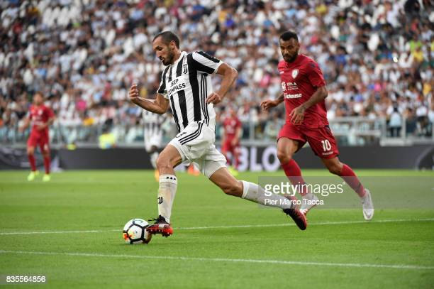 Giorgio Chiellini of Juventus competes for the ball with Geraldino Joao Pedro of Cagliari Calcio during the Serie A match between Juventus and...
