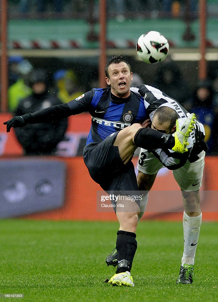 Giorgio Chiellini of Juventus FC (R) and Antonio Cassano of FC Inter Milan compete for the ball during the Serie A match between FC Internazionale Milano and Juventus FC at San Siro Stadium on March 30, 2013 in Milan, Italy.