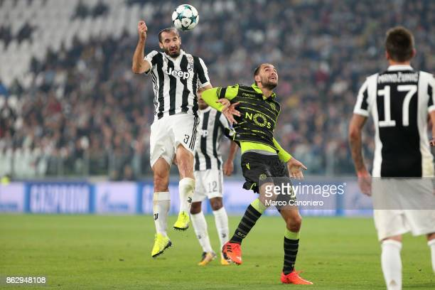 Giorgio Chiellini of Juventus FC and Bas Dost of Sporting Clube de Portugal in action during the UEFA Champions League group D match between Juventus...