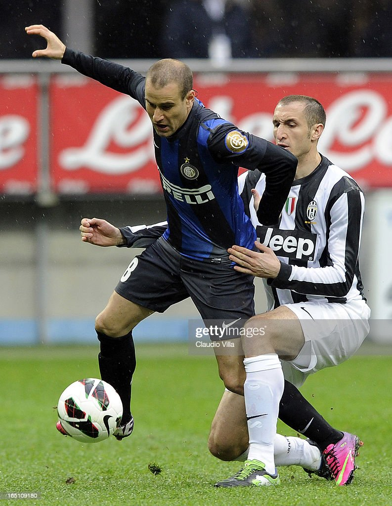 Giorgio Chiellini of Juventus FC (R) and Rodrigo Palacio of FC Inter Milan compete for the ball during the Serie A match between FC Internazionale Milano and Juventus FC at San Siro Stadium on March 30, 2013 in Milan, Italy.