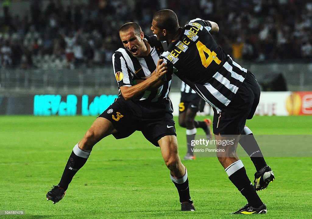 <a gi-track='captionPersonalityLinkClicked' href=/galleries/search?phrase=Giorgio+Chiellini&family=editorial&specificpeople=605793 ng-click='$event.stopPropagation()'>Giorgio Chiellini</a> (L) of Juventus FC celebrates his goal with <a gi-track='captionPersonalityLinkClicked' href=/galleries/search?phrase=Felipe+Melo&family=editorial&specificpeople=646942 ng-click='$event.stopPropagation()'>Felipe Melo</a> during the Uefa Europa League group A match Juventus FC and KKS Lech Poznan at Olimpico Stadium on September 16, 2010 in Turin, Italy.