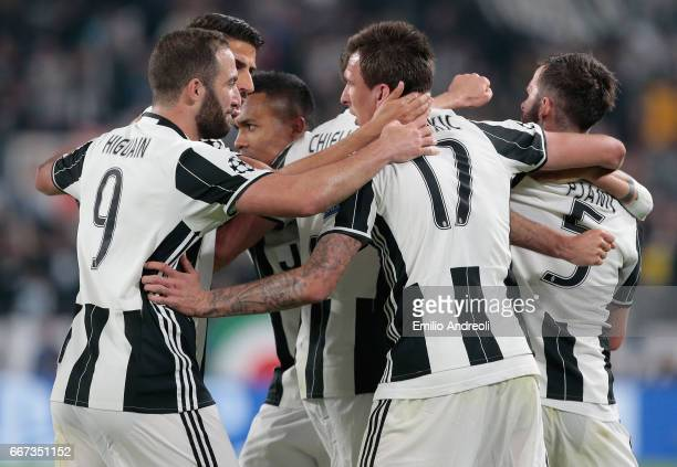 Giorgio Chiellini of Juventus FC celebrates his goal with his teammates during the UEFA Champions League Quarter Final first leg match between...