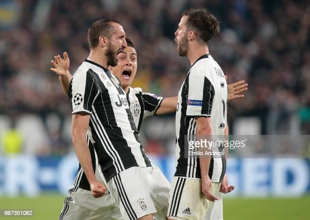 Giorgio Chiellini of Juventus FC celebrates his goal with his teammate Paulo Dybala and Miralem Pjanic during the UEFA Champions League Quarter Final...
