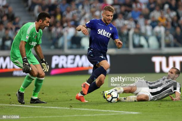 Giorgio Chiellini of Juventus FC Ciro Immobile of SS Lazio and Gianluigi Buffon of Juventus Fc in action during the Serie A football match between...