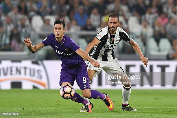 Giorgio Chiellini of Juventus FC competes with Nikola Kalinic of ACF Fiorentina during the Serie A match between Juventus FC and ACF Fiorentina at...