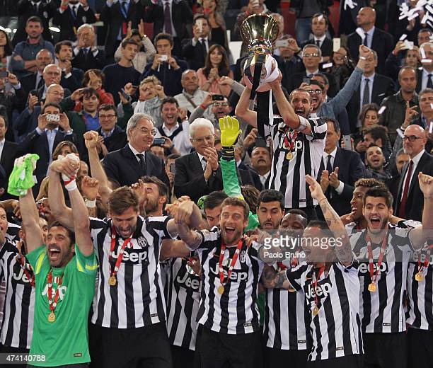 Giorgio Chiellini of Juventus FC holds the trophy after winning the TIM Cup final match against SS Lazio at Olimpico Stadium on May 20 2015 in Rome...