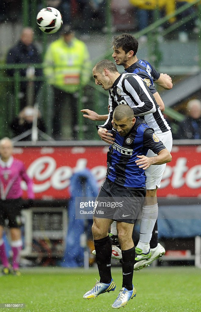 Giorgio Chiellini of Juventus FC (C), Walter Samuel #5 and Andrea Ranocchia of FC Inter Milan compete for the ball during the Serie A match between FC Internazionale Milano and Juventus FC at San Siro Stadium on March 30, 2013 in Milan, Italy.