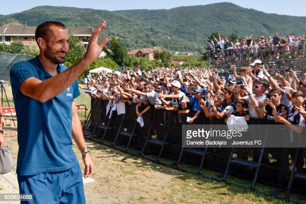 Giorgio Chiellini of Juventus greets fans during the preseason friendly match between Juventus A and Juventus B on August 17 2017 in Villar Perosa...