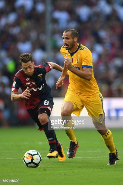 Giorgio Chiellini of Juventus in action against Andrea Bertolacci of Genoa CFC during the Serie A match between Genoa CFC and Juventus at Stadio...