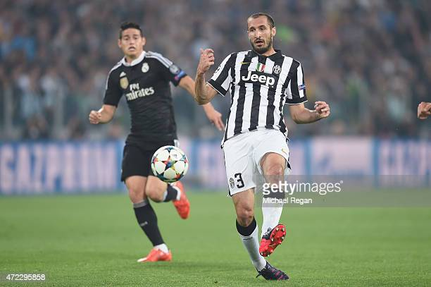 Giorgio Chiellini of Juventus in action with James Rodriguez of Real Madrid during the UEFA Champions League semi final match between Juventus and...