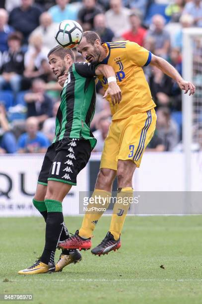 Giorgio Chiellini of Juventus is challenged by Diego Falcinelli of Sassuolo during the Serie A match between Sassuolo and Juventus at Mapei Stadium...