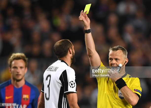 Giorgio Chiellini of Juventus is shown a yellow card by referee Bjorn Kuipers during the UEFA Champions League Quarter Final second leg match between...