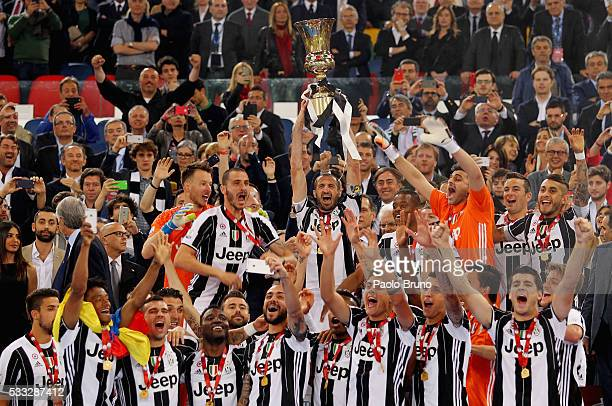 Giorgio Chiellini with his teammates of Juventus FC celebrate with the trophy after winning the TIM Cup final match against AC Milan at Stadio...