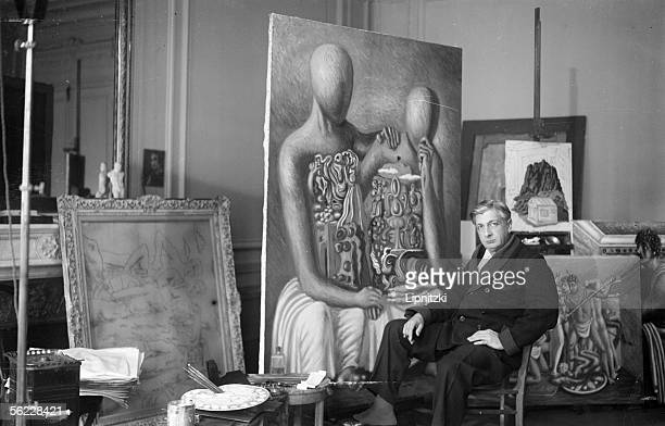 Giorgio De Chirico Italian painter in front of his works