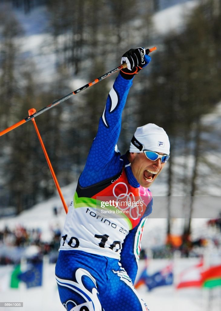 Giorgio di Centa of Italy celebrates winning the Gold Medal in the Mens Cross Country Skiing 50km Mass Start Final on Day 16 of the 2006 Turin Winter...