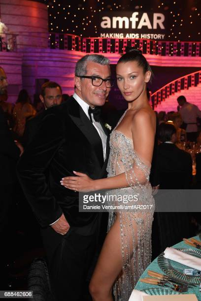 Giorgio Guidotti and Bella Hadid attend the amfAR Gala Cannes 2017 at Hotel du CapEdenRoc on May 25 2017 in Cap d'Antibes France