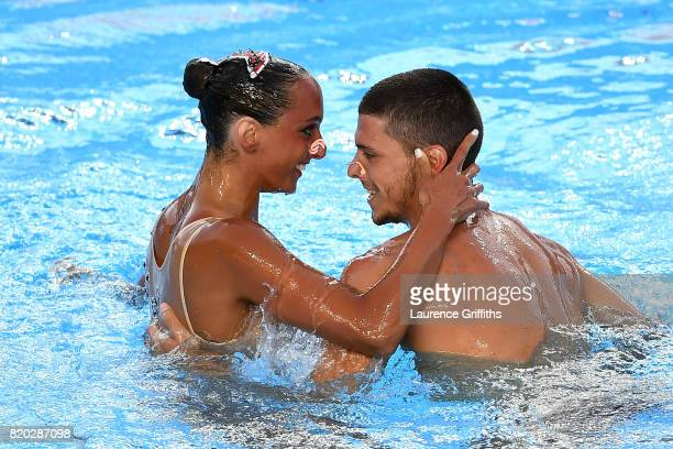 Giorgio Minisini and Mariangela Perrupato of Italy compete during the Synchronised Swimming Mixed Duet Free preliminary round on day eight of the...