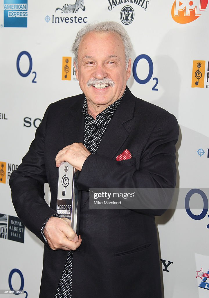 <a gi-track='captionPersonalityLinkClicked' href=/galleries/search?phrase=Giorgio+Moroder&family=editorial&specificpeople=3147062 ng-click='$event.stopPropagation()'>Giorgio Moroder</a> attends the Nordoff Robbins 02 Silver Clef awards at London Hilton on July 4, 2014 in London, England.