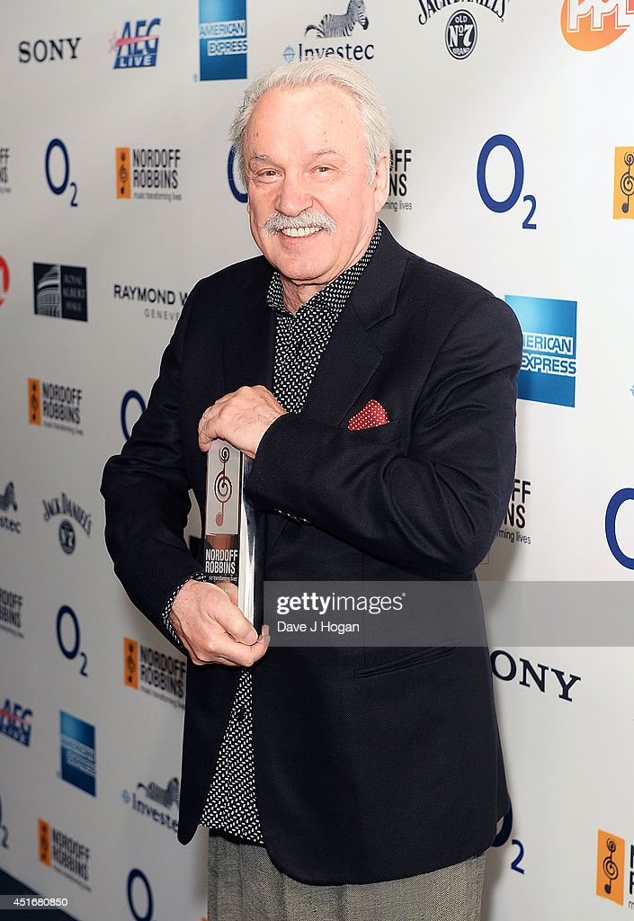 <a gi-track='captionPersonalityLinkClicked' href=/galleries/search?phrase=Giorgio+Moroder&family=editorial&specificpeople=3147062 ng-click='$event.stopPropagation()'>Giorgio Moroder</a> with his Classical Award at the Nordoff Robbins 02 Silver Clef awards at London Hilton on July 4, 2014 in London, England.